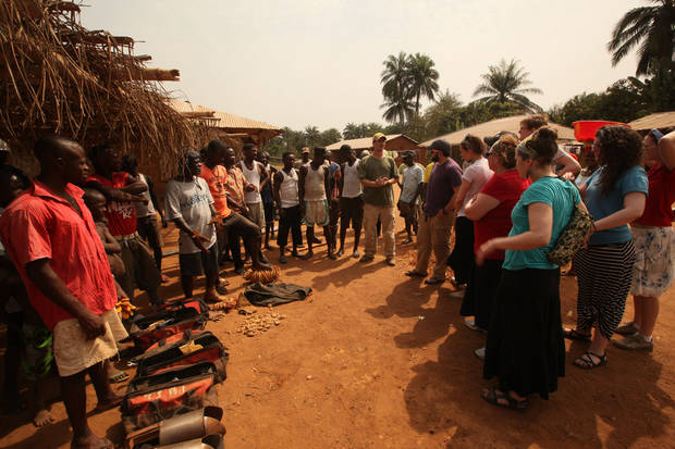 Gospel recording artist Sandi Patty and other members of a Water4 mission team talk with villagers in Sierra Leone.