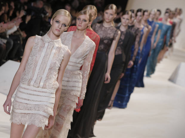 Models wear creations by designer Elie Saab as part of his ready to wear Spring-Summer 2013 collection, in Paris, Wednesday, Oct. 3, 2012. (AP Photo/Francois Mori)