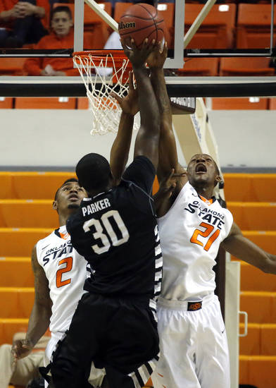 Oklahoma State's Le'Bryan Nash (2) and Kamari Murphy (21) defend against Portland State's Renado Parker (30) during the college basketball game between Oklahoma State University and Portland State, Sunday,Nov. 25, 2012. Photo by Sarah Phipps, The Oklahoman