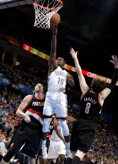 Oklahoma City's Reggie Jackson (15) shoots a lay up in between Portland 's Joel Przybilla (10) and Luke Babbitt (8) during the NBA basketball game between the Oklahoma City Thunder and the Portland Trailblazers at Chesapeake Energy Arena in Oklahoma City, Sunday, March 18, 2012. Photo by Sarah Phipps, The Oklahoman.