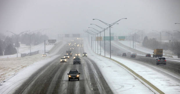 Snow art. Traffic on the Broadway Extension from Britton looking south,  Friday, December 28, 2012.  Photo By David McDaniel/The Oklahoman
