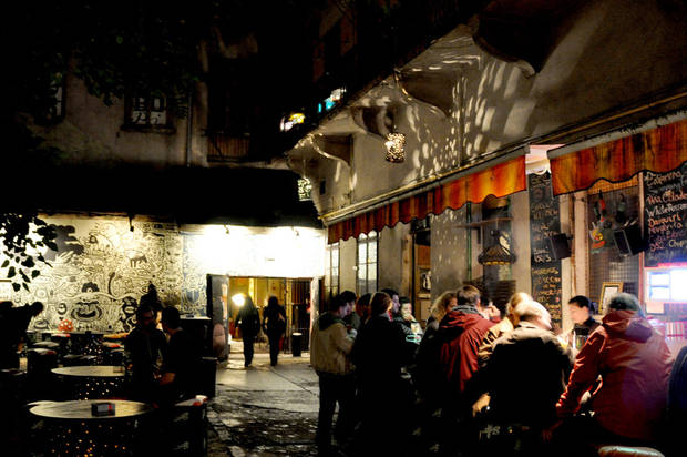 The eclectic �ruin pub� scene in Budapest, Hungary, usually spills out of the bars and into courtyards.  Photo by Cameron Hewitt