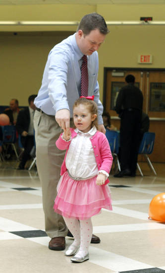 Jarod Virden and his four year old daughter Evelyn share a dance during the Deer Creek Daddy daughter dance at Deer Creek High School in Oklahoma City, OK, Saturday, January 26, 2013,  By Paul Hellstern, The Oklahoman