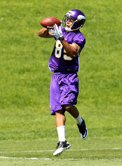 Minnesota Vikings wide receiver Greg Childs makes a catch during rookie football mini-camp, Friday, May 4, 2012, in Eden Prairie, Minn. Childs was an NFL fourth-round draft pick. (AP Photo/Genevieve Ross)