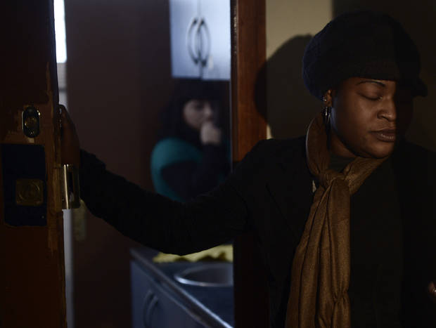 Cynthia Odigie waits for her eviction in Barcelona, Spain, Thursday, Nov. 15, 2012. The Spanish government on Thursday passed a decree suspending evictions of the most vulnerable homeowners unable to pay their mortgage, a bid to ease a trend that has seen hundreds of thousands of people lose their homes because of the brutal economic crisis. The eviction was finally suspended. (AP Photo/Manu Fernandez)