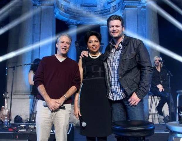 Event host Jon Stewart, Chairman and Chief Executive Officer of PepsiCo Indra Nooyi and Oklahoma country music superstar Blake Shelton pose for a photo during the event.