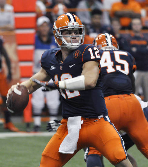 Syracuse quarterback Ryan Nassib throws against Pittsburgh during the first quarter of an NCAA college football game in Syracuse, N.Y., Friday, Oct. 5, 2012. (AP Photo/Kevin Rivoli)