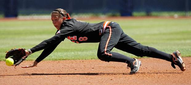Oklahoma State's Chelsea Garcia (8) dives for the ball in the first inning of a Women's College World Series softball game between Oklahoma State University and California at ASA Hall of Fame Stadium in Oklahoma City, Saturday, June 4, 2011. California won, 6-2. Photo by Bryan Terry, The Oklahoman