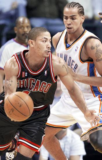 Chicago's Derrick Rose, left, dribbles past Thabo Sefolosha of the Thunder during Wednesday's game at the Ford Center. PHOTO BY NATE BILLINGS, THE OKLAHOMAN