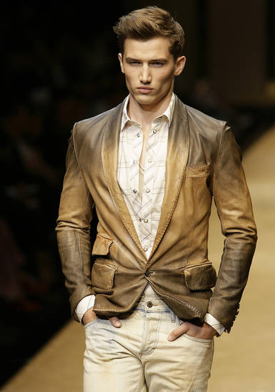 A model wears a creation part of the D&G Spring/Summer 2009/2010 men's collection, by Domenico Dolce and Stefano Gabbana, presented in Milan, Italy, Tuesday, June 23, 2009. (AP Photo/Alberto Pellaschiar) ORG XMIT: MIL145