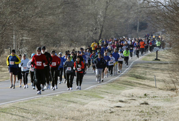 Runners bundled up for cold tempeartures during the 10K Deer Creek Classic at Deer Creek High School in Oklahoma City early this March. Photo By Paul Hellstern, The Oklahoman
