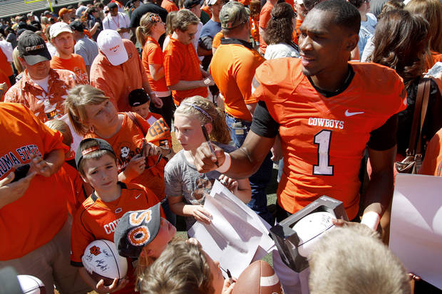 OSU's Joseph Randle meets fans after Oklahoma State's spring football game at Boone Pickens Stadium in Stillwater, Okla., Saturday, April 21, 2012. Photo by Bryan Terry, The Oklahoman
