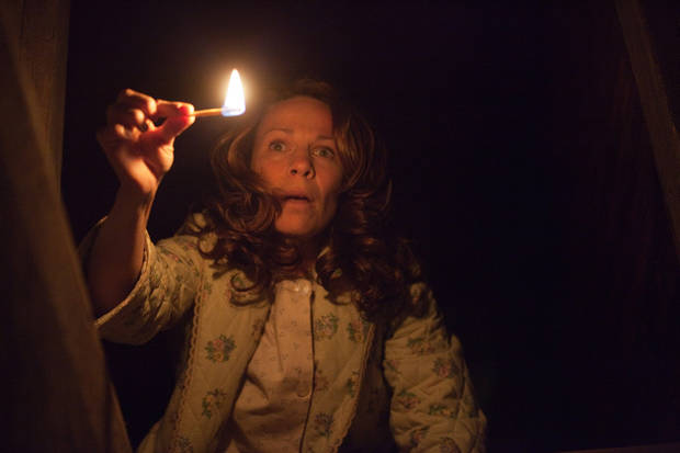 "In this publicity image released by Warner Bros. Pictures, Lili Taylor portrays Carolyn Perron in a scene from ""The Conjuring."" (AP Photo/New Line Cinema/Warner Bros. Pictures, Michael Tackett) ORG XMIT: NYET267"