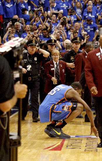 Oklahoma City's Kevin Durant (35) pauses on the court after Oklahoma City's loss in game 5 of the Western Conference Finals in the NBA basketball playoffs between the Dallas Mavericks and the Oklahoma City Thunder at American Airlines Center in Dallas, Wednesday, May 25, 2011. Photo by Bryan Terry, The Oklahoman