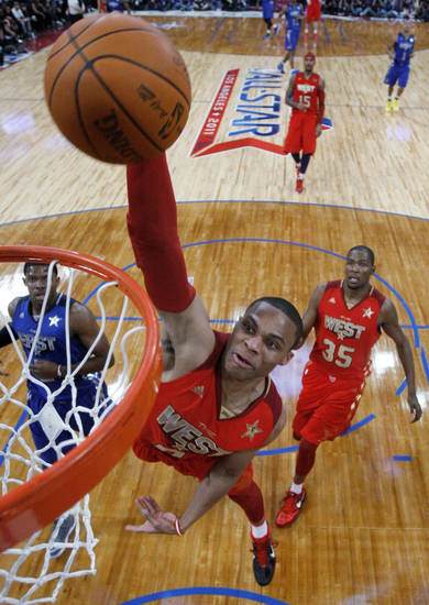 West's Russell Westbrook, of the Oklahoma City Thunder, goes up for a dunk during the first half of the NBA basketball All-Star Game on Sunday, Feb. 20, 2011, in Los Angeles. (AP Photo/Pool, Lucy Nicholson)
