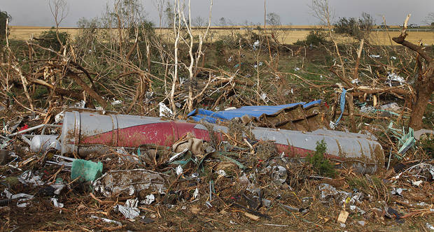 A semi truck trailer is buried in debris after being swept off I-40 by a tornado west of El Reno, Tuesday, May 24, 2011. Photo by Chris Landsberger, The Oklahoman ORG XMIT: KOD