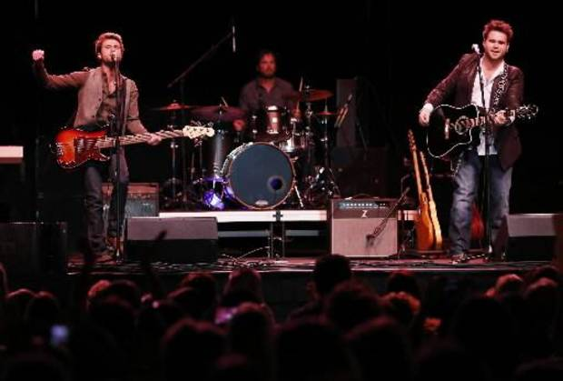 The Swon Brothers, from left, Colton and Zach Swon, perform a free homecoming concert at the Muskogee Civic Center in Muskogee, Okla., Thursday, June 6, 2013. Photo by Garett Fisbeck/Tulsa World