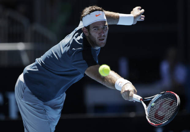 Argentina&#039;s Juan Martin Del Potro reaches for a backhand return to France&#039;s Jeremy Chardy during their third round match at the Australian Open tennis championship in Melbourne, Australia, Saturday, Jan. 19, 2013. (AP Photo/Rob Griffith)