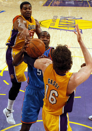 Oklahoma City's Kendrick Perkins (5) grabs a rebound between Los Angeles' Andrew Bynum (17) and Pau Gasol (16) during Game 3 in the second round of the NBA basketball playoffs between the L.A. Lakers and the Oklahoma City Thunder at the Staples Center in Los Angeles, Friday, May 18, 2012. Photo by Nate Billings, The Oklahoman