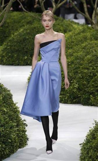 A model presents a creation by Raf Simons for Christian Dior's Spring Summer 2013 Haute Couture fashion collection, presented in Paris, Monday, Jan.21, 2013. (AP Photo/Christophe Ena)