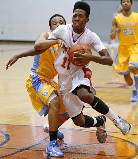 Carl Albert's Javeion Gray , right, goes past Putnam CIty West's Steven Stallings during their high school basketball game at Carl Albert in Midwest City, Okla., Friday, Jan. 25, 2013. Photo by Bryan Terry, The Oklahoman