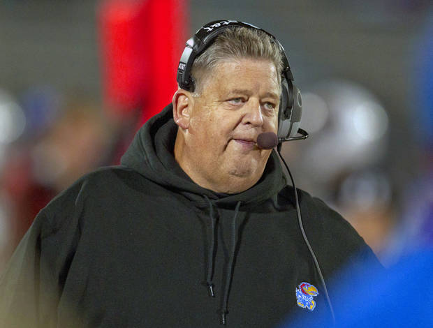 Kansas coach Charlie Weis watches from the sidelines during the second half of an NCAA college football game against Iowa State in Lawrence, Kan., Saturday, Nov. 17, 2012. Iowa State defeated Kansas 51-23. (AP Photo/Orlin Wagner) ORG XMIT: KSOW116