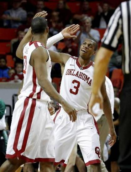 Oklahoma's Buddy Hield (3) celebrates with Cameron Clark (21) during an NCAA college basketball game between the University of Oklahoma (OU) and Ohio at the Lloyd Noble Center in Norman, Saturday, Dec. 29, 2012. Oklahoma won 74-63. Photo by Bryan Terry, The Oklahoman