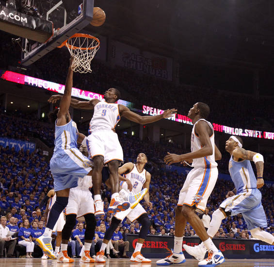 Oklahoma City's Serge Ibaka (9) defends Denver's Nene (31) during the NBA basketball game between the Denver Nuggets and the Oklahoma City Thunder in the first round of the NBA playoffs at the Oklahoma City Arena, Sunday, April 17, 2011. Photo by Bryan Terry, The Oklahoman