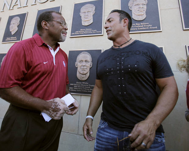 Dewey Selmon talks with Tony Casillas at the unveiling of the National Honors display before the college football game between the University of Oklahoma Sooners (OU) and Utah State University Aggies (USU) at the Gaylord Family-Oklahoma Memorial Stadium on Saturday, Sept. 4, 2010, in Norman, Okla.   Photo by Steve Sisney, The Oklahoman