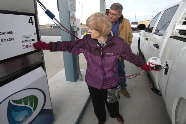 MayorCindy Rosenthal fills a city vehicle with compressed natural gas during a tour of the new CNG pumping facility Tuesday, Jan. 10, 2012, in Norman, Okla.  At right is Greg Hall. Photo by Steve Sisney, The Oklahoman
