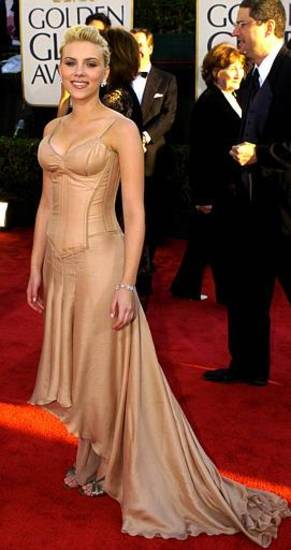 "Scarlett Johansson, nominated for best actress in a musical or comedy for her work in ""Lost in Translation,"" and best actress in a drama for ""Girl with a Pearl Earring,"" arrives for the 61st Annual Golden Globe Awards on Sunday, Jan. 25, 2004, in Beverly Hills, Calif.  (AP Photo/Mark J. Terrill)"