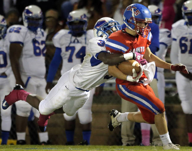 Millwood's Cameron Batson brings down OCS' Luke Frankfurt during the high school football game between Oklahoma Christian and Millwood at Oklahoma Christian Schools in Edmond, Okla.,  Friday, Oct. 5, 2012. Photo by Sarah Phipps, The Oklahoman