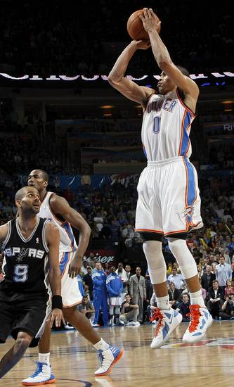 Oklahoma City's Russell Westbrook (0) shoots a jumper near Serge Ibaka (9) and San Antonio's Tony Parker (9) during the NBA basketball game between the Oklahoma City Thunder and the San Antonio Spurs at Chesapeake Energy Arena in Oklahoma City, Friday, March 16, 2012. San Antonio won, 114-105. Photo by Nate Billings, The Oklahoman