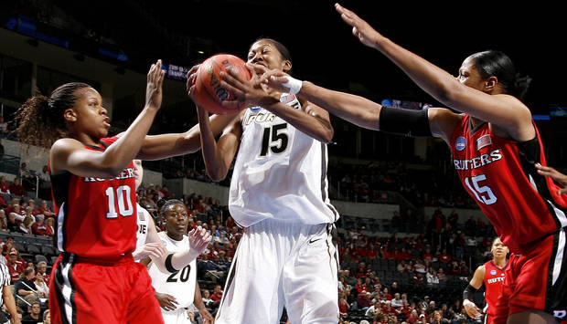 Purdue's Danielle Campbell grabs the ball between Rutgers' Khadijah Rushdan, left, and Kia Vaughn during the NCAA women's basketball tournament game between Rutgers and Purdue at the Ford Center in Oklahoma City, Sunday, March 29, 2009.  PHOTO BY BRYAN TERRY, THE OKLAHOMAN