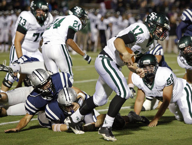 Edmond Santa Fe's Ty Hensley runs for a touchdown against Edmond North during a high school football game at Wantland Stadium in Edmond, Okla., Friday, Oct. 29, 2010.  Photo by Bryan Terry, The Oklahoman