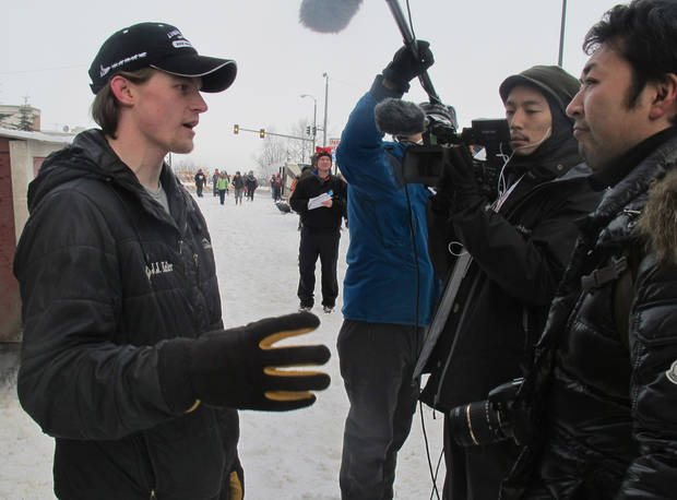 Defending champion Dallas Seavey, left, is interviewed by Japanese media before the ceremonial start of the 2013 Iditarod Trail Sled Dog Race in Anchorage, Alaska on Saturday, March 2, 2013. The race, which will take mushers about a thousand miles across the Alaska wilderness, starts Sunday, March 3, 2013, in Willow, Alaska. (AP Photo/Mark Thiessen)