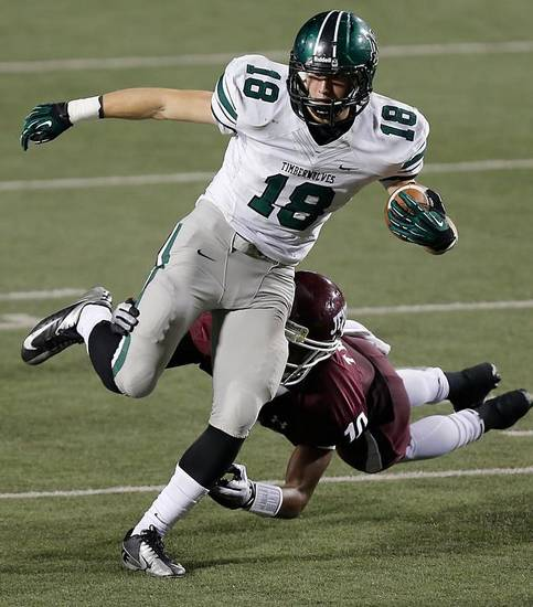 Norman North's Tyler Sipe (18) makes a reception in front of Jenks' Steven Parker  (10) during the Class 6A Oklahoma state championship football game between Norman North High School and Jenks High School at Boone Pickens Stadium on Friday, Nov. 30, 2012, in Stillwater, Okla.   Photo by Chris Landsberger, The Oklahoman
