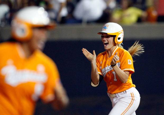 University of Tennessee's Erinn Webb celebrates a grand slam home run during the Women's College World Series game between Georgia and Tennessee Friday, June 4, 2010, in Oklahoma City. Photo by Sarah Phipps, The Oklahoman
