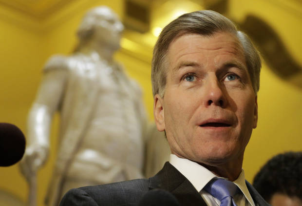 Virginia Gov. Bob McDonnell speaks to the press in front of a statue of George Washington at the Capitol Tuesday, Feb.  5, 2013 in Richmond, Va.  McDonnell called for a yes vote on his transportation bill.  The House approved the legislation.  (AP Photo/Steve Helber)