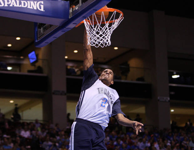 OKC Thunder player Thabo Sefolosha dunks during the Blue-White scrimmage at the SpiritBank Event Center, on Thursday, Oct. 18, 2012. CORY YOUNG/Tulsa World