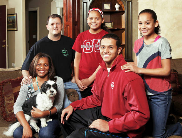 Top row from left: Former OU football player Scott Evans, and daughters Jessika, 11, and Jacie, 12. Bottom row from left: Scott�s wife, Tenika, with family pet Koda, and Jordan, 18. Photo by Jim Beckel, The Oklahoman