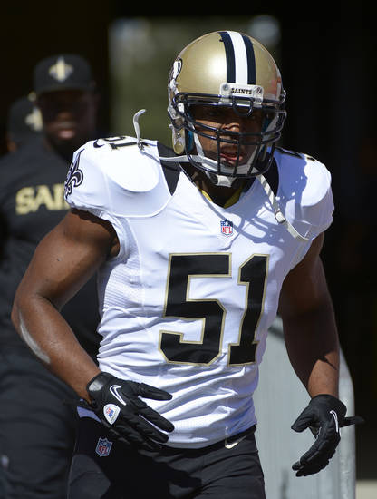 FILE - This Oct. 21, 2012 file photo shows New Orleans Saints football linebacker Jonathan Vilma (51) running onto the field in Tampa, Fla., Sunday, Oct. 21, 2012. Former NFL Commissioner Paul Tagliabue and lawyers for the league and the players' union have arrived in Washington, Thursday for a hearing in the Saints bounties case. Tagliabue is overseeing the latest round of player appeals in Washington. Vilma and fellow player Will Smith, who were suspended said they plan to attend. (AP Photo/Phelan M. Ebenhack, File)