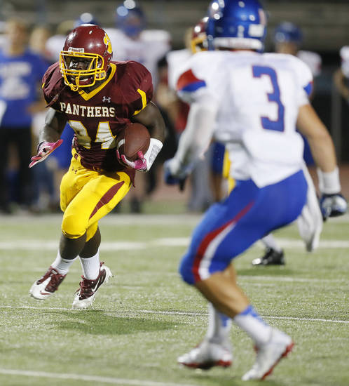 Putnam City North's Nathaniel Ocran (24) carries the ball for a long gain during a high school football game between Putnam City North and Moore at Putnam City Stadium in Oklahoma City, Thursday, Sept. 27, 2012. Photo by Nate Billings, The Oklahoman