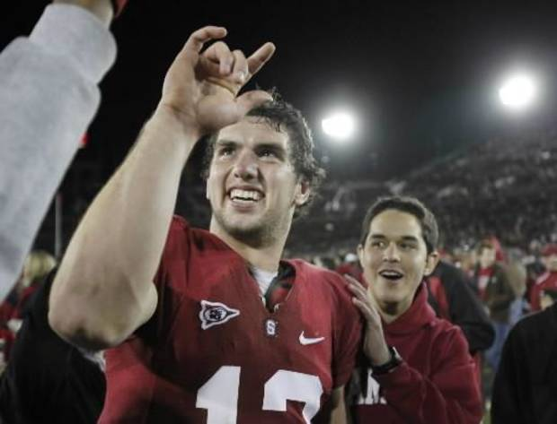 Stanford quarterback  Andrew  Luck (12) celebrates after Stanford defeated Notre Dame 45-38 in their NCAA college football game in Stanford, Calif., Saturday, Nov. 28, 2009. (AP Photo/Paul Sakuma)