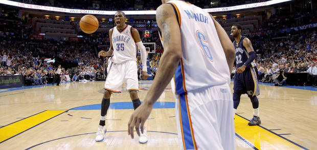 Oklahoma City's Kevin Durant reacts beside O.J. Mayo of Memphis during the NBA basketball game between the Oklahoma City Thunder and the Memphis Grizzlies at the Ford Center in Oklahoma City on Wednesday, April 14, 2010. 
