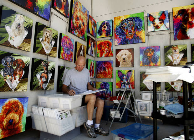 Gainsville, Florida digital artist Gregg Billman sorts and catalogs Monday, April 21, 2012 in preparation for the Festival of the Arts starting Tuesday. Photo by Doug Hoke, The Oklahoman
