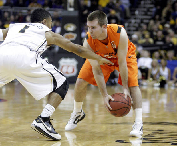 Oklahoma's Keiton Page (12) looks to get by Missouri's Phil Pressey (1) during the Big 12 tournament men's basketball game between the Oklahoma State Cowboys and Missouri Tigers the Sprint Center, Thursday, March 8, 2012. Photo by Sarah Phipps, The Oklahoman