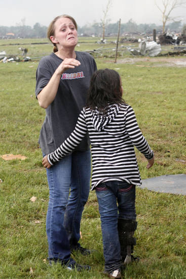 A parent finds her child at Briarwood Elementary school after a tornado destroyed the school in south OKC Oklahoma City, OK, Monday, May 20, 2013. Near SW 149th and Hudson.  By Paul Hellstern, The Oklahoman