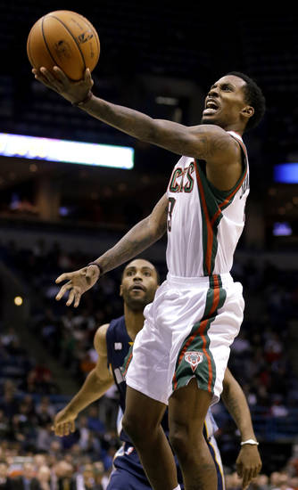 Milwaukee Bucks' Brandon Jennings puts up a shot against Memphis Grizzlies' Wayne Ellington, rear. during the second half of an NBA basketball game, Wednesday, Nov. 7, 2012, in Milwaukee. (AP Photo/Jeffrey Phelps)