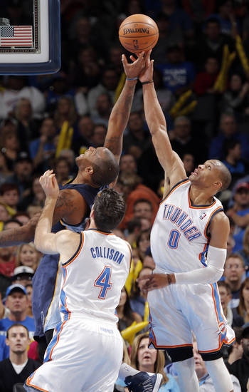 Oklahoma City's Russell Westbrook (0) and Nick Collison (4) go after a rebound against Memphis' Marreese Speights (5) during the NBA basketball game between the Oklahoma City Thunder and the Memphis Grizzlies at Chesapeake Energy Arena on Wednesday, Nov. 14, 2012, in Oklahoma City, Okla.   Photo by Chris Landsberger, The Oklahoman